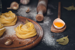 Raw homemade pasta with flour and spices on the rustic background. stock photography