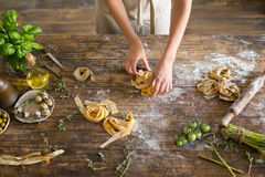 Raw homemade pasta and hands Royalty Free Stock Photography