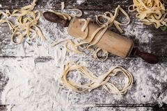 Raw homemade pasta with infinity symbol Royalty Free Stock Images