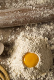 Raw homemade pasta and ingredients for pasta on wooden backgroun. D Royalty Free Stock Images