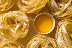 Raw homemade pasta and ingredients for pasta on wooden backgroun. D Stock Photo