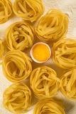 Raw homemade pasta and ingredients for pasta on wooden backgroun. D Royalty Free Stock Photos