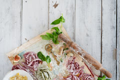 Raw homemade pasta nests. Over old map and wooden background Royalty Free Stock Photo