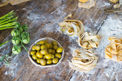 Raw homemade pasta. Over wooden background Stock Images