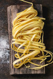 Raw homemade pasta tagliatelle Royalty Free Stock Photos
