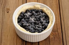 Raw homemade round open pie with whole wild blueberries with sug Royalty Free Stock Photography