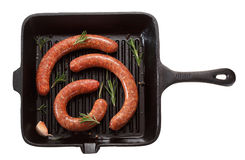 Raw homemade sausage for grilling in the pan. Isolated on white. Background. The view from the top Royalty Free Stock Image