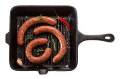 Raw homemade sausage for grilling in the pan. Isolated on white Stock Image
