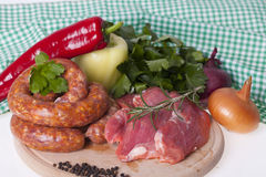 Raw homemade sausages and fresh pork meat Royalty Free Stock Photo