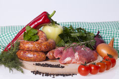 Raw homemade sausages and fresh pork meat Stock Photo