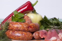 Raw homemade sausages and fresh pork Stock Photography