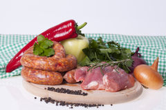 Raw homemade sausages and fresh pork Stock Image