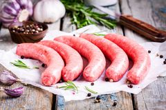 Raw homemade sausages on a paper Stock Images