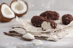 Raw homemade vegan chocolate coconut candy bounty, white backgro. Raw homemade vegan chocolate coconut dessert bounty. Healthy vegan food concept stock photography