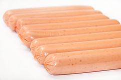 Raw hot dogs on a white background Royalty Free Stock Image