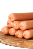 Raw hot dogs on a wooden board Stock Images