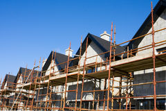 Raw of houses roofs with scaffolds Royalty Free Stock Image