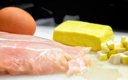 Raw ingredient of Egg, Tofu and Chicken Breast on a Cutting Board royalty free stock photography