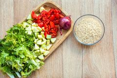 Raw ingredients, brown rice and vegetables Stock Photos