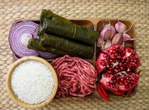 Raw ingredients for cooking dolma. Grape leaves, beef and pomegranate. royalty free stock photo