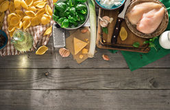 Raw ingredients for cooking Italian pasta on wooden table Royalty Free Stock Photography