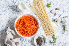 Raw ingredients for cooking pumpkin noodles spaghetti. On a light background Stock Image