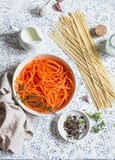 Raw ingredients for cooking pumpkin noodles spaghetti. On a light background Royalty Free Stock Photos