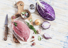 Raw ingredients - meat, red cabbage, onion, garlic, spices and herbs. Cooking delicious and healthy lunch. Stock Image