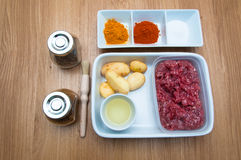 Raw ingredients minced meat potato and spices stock photo