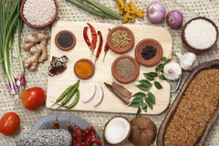 Raw Ingredients mixture. Includes a variety of ingredients from cumin, fennel, coriander, cardamom, cinnamon, cloves, poppy seeds, saffron, pepper, chilies, and Stock Photo