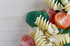Raw ingredients for pasta. On a wooden background Stock Image