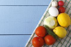 Raw ingredients on wooden background. Fresh vegetables and egg for cooking. Top view with copy space.  Royalty Free Stock Photography