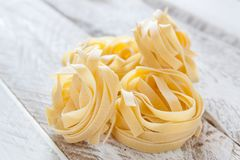 Raw Italian fettuccine nests Stock Images