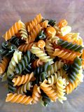 Raw Italian pasta, colorful spirals stock photo