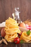 Raw italian pasta and ingredient Royalty Free Stock Photography