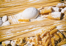 Raw Italian pasta and ingredients. Pasta preparation Royalty Free Stock Photos