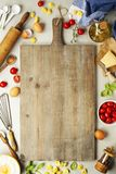 Raw italian pasta tortellini on wooden board. Raw italian pasta tortellini with ingredients on wooden board. Top view Royalty Free Stock Image