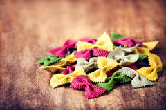 Raw Italian Pasta on wooden table with copyspace for text.  Raw Stock Photo