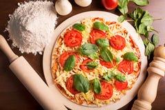 Raw Italian pizza Royalty Free Stock Photo