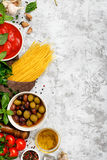 Raw Italian spaghetti with food ingredients Royalty Free Stock Photography
