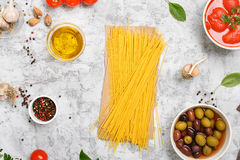 Raw Italian spaghetti with food ingredients Royalty Free Stock Photo