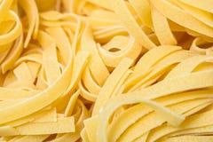 Raw Italian Tagliatelle Pasta. Abstract Stock Image