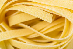 Raw Italian Tagliatelle Pasta. Abstract Stock Images