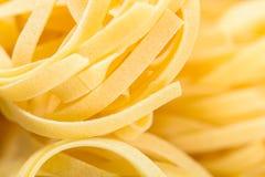 Raw Italian Tagliatelle Pasta. Abstract Stock Photos