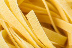 Raw Italian Tagliatelle Pasta. Abstract Royalty Free Stock Image