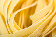 Raw Italian Tagliatelle Pasta. Abstract Royalty Free Stock Photos