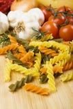 Raw italian tricolore pasta Stock Images