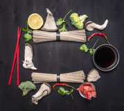 Raw Japanese buckwheat noodles with ginger, oyster mushrooms, soy sauce lined frame on wooden rustic background top view , place f stock photos