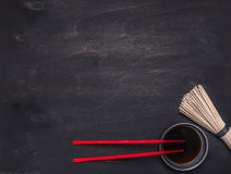 Raw Japanese buckwheat noodles with soy sauce and red chopsticks place for text,frame wooden rustic background top view royalty free stock photos