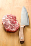 Raw juicy meat with knife Royalty Free Stock Photography